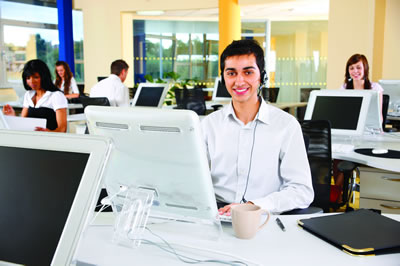 Young man at work in Call Centre